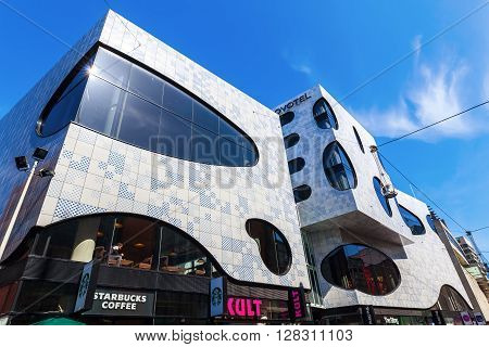 The Hague Netherlands - April 21 2016: Novotel Suites with shopping arcade De Passage. It was designed by Bernard Tschumi Architects and realized in 2014