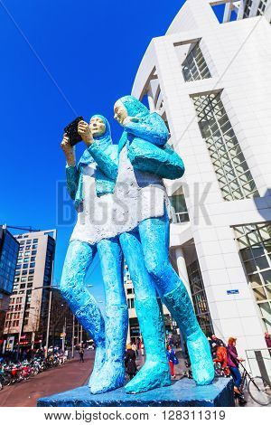 The Hague Netherlands - April 21 2016: sculpture in front of the New City Hall of The Hague with unidentified people. It was designed in 1986 by American architect Richard Meier and completed 1995