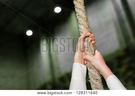 Close up Photo of Hands of Woman climbing on hawser