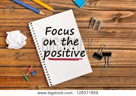 Words Focus on the positive on notebook