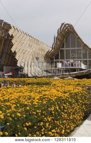 MILAN, ITALY - JUNE 29 2015: External view of Chinese Pavillion at Expo 2015 in Milan with its garden full of yellow flowers
