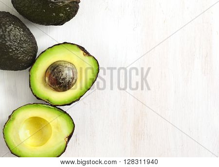 Fresh ripe avocado on wooden background with copy space