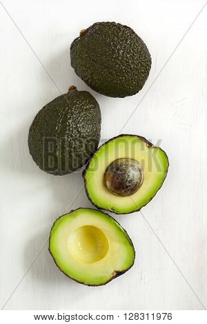 Fresh ripe avocado on wooden background. Top view.