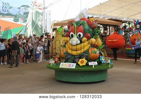 MILAN, ITALY - JUNE 29 2016: Foody Expo 2015 Mascotte during the parade through people at Universal Exhibition in Milan, held from May to October 2015