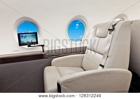 Aircraft porthole with clouds view, flight by business class