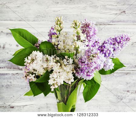 Bouquet of beautiful Lilac on wooden background