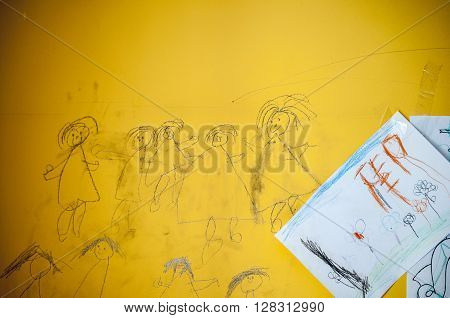 Children drawing on the wall of the family