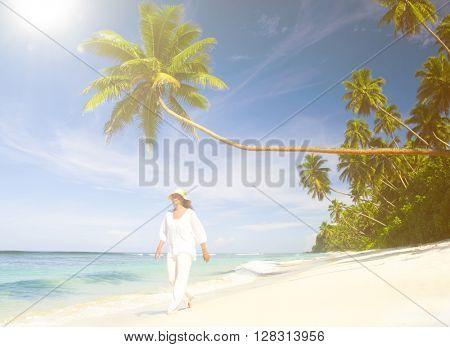 Woman walking on a tropical beach.