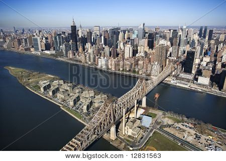 Aerial view of Queensboro Bridge in New York City with Rooseveldt Island and  Manhattan cityscape.
