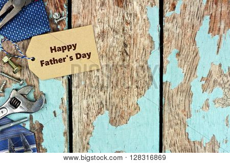 Happy Father's Day Tag And Side Border Of Tools On Rustic Blue Wood Background