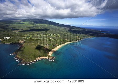 Aerial of coastline with sandy beach and crater and Pacific ocean in Maui, Hawaii.