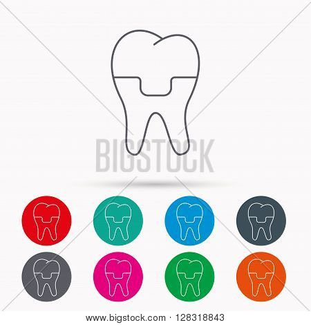 Dental crown icon. Tooth prosthesis sign. Linear icons in circles on white background.
