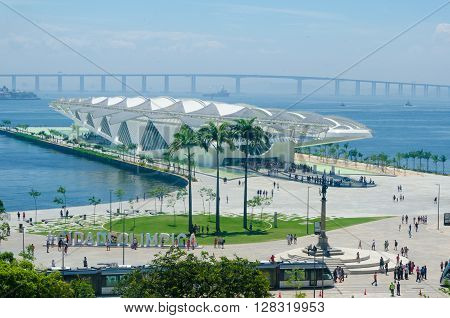 Rio de Janeiro Brasil - March 06 2016: Sign Letters City in front of the Museu do Amanhã and VLT Carioca - Light vehicle on rails stands in Maua Plaza in the regenerated Porto Maravilha area.