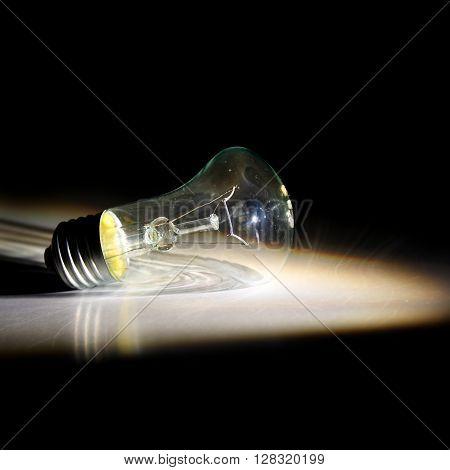 light bulb in an unusual light. black background