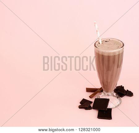 Delicious milkshake on a pink background