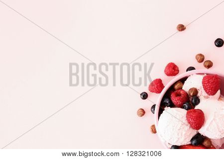 Yummy ice cream with berries, on a pink background