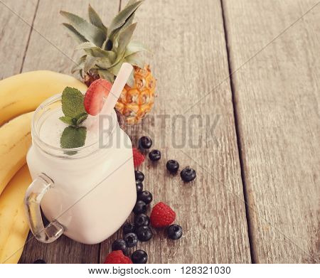 Delicious milkshake on the wooden table
