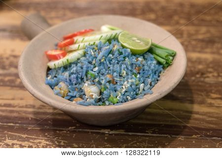 Fried Blue rice from petal of butterfly pea flowers