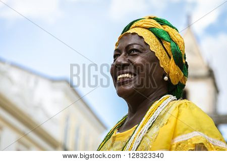 Brazilian woman of African descent wearing traditional clothes from the state of Bahia in the old colonial district of Salvador (Pelourinho).