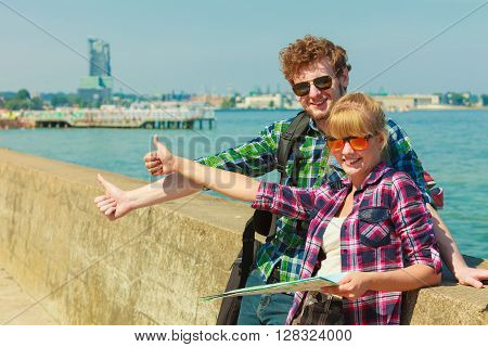 Couple Backpacker With Map By Seaside Hitchhiking