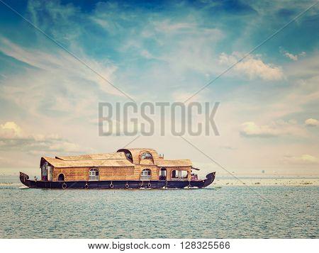 Kerala India travel concept background - vintage retro effect filtered hipster style image of houseboat in Vembanadu Lake, Kerala, India