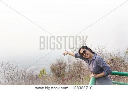 Asian Lady Smiling And Relax On Highland Top View Seeing Point With Nature Background