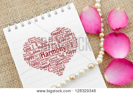 Love on open diary on with rose on sack background.