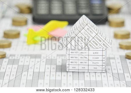 Close Up House Have Blur Airplane And Calculator As Background