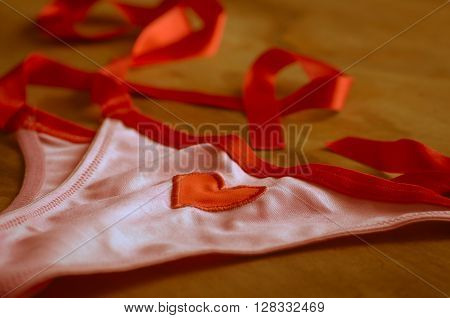 Red and heart underware at table wood