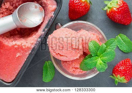 Homemade strawberry sorbet on a gray slate top view