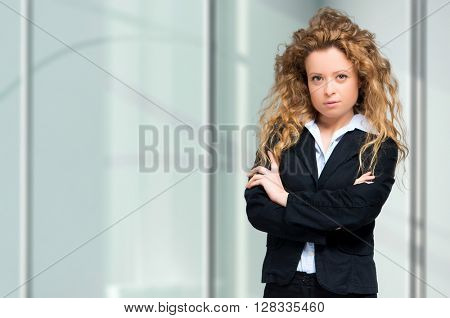 Smiling young businesswoman with copy-space.