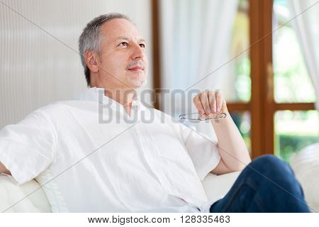 Smiling man relaxing on the couch