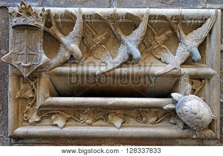 BARCELONA, SPAIN - AUGUST 3, 2015: Wall stone sculptures of animals in Barcelona