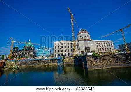 BERLIN, GERMANY - JUNE 06, 2015: Berlin city Palace reconstruction at the bottom of museum island, behind the famous Cathedral. Historic buidings