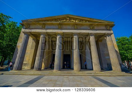 BERLIN, GERMANY - JUNE 06, 2015: Frontal facade of Neue Wache museum, mother and son died inside. Monument for war victims.