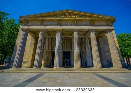 BERLIN, GERMANY - JUNE 06, 2015: People visiting the New Guard museum in Berlin, frontal facade of this historic buiding
