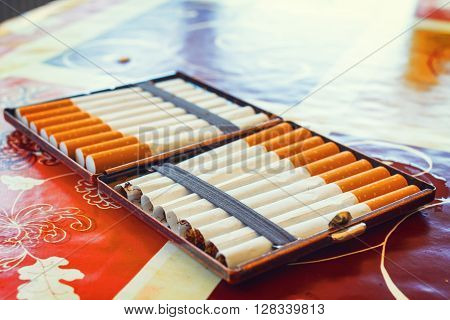 close up of hand made cigarettes lying on the table