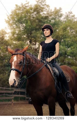 Happy Horsewoman Ridding Her Horse in a Manege