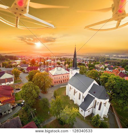 Beautiful sunset over gothic church St. Peter and Paul in The Litice suburb of Pilsen. Aerial view from drone to romantic citiscape in Czech Republic, Central Europe. HDR (warm filtered) photography.