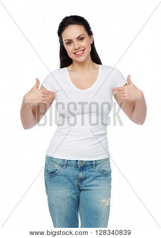 advertisement, clothing and people concept - happy smiling young woman or teenage girl in white t-shirt pointing finger to herself