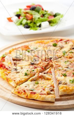 Pizza with Mozzarella, Bacon and Mushrooms. Served with Greek Salad