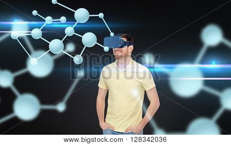 3d technology, virtual reality, biology, entertainment and people concept - happy young man in virtual reality headset or 3d glasses looking at molecules over black background