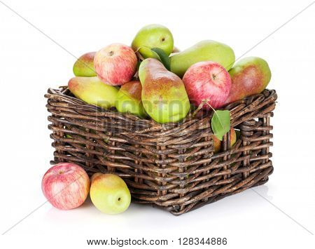 Pears and apples in basket. Isolated on white background