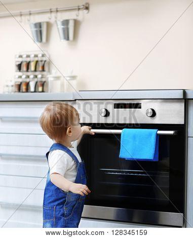 Cute baby in kitchen