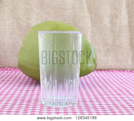 Healthy drink tender coconut water in a glass cup.