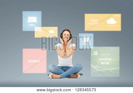 technology, music and happiness concept - smiling young woman or teen girl in headphones over virtual screens and web applications on gray background