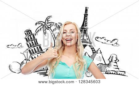 people, tourism, vacation and summer holidays concept - smiling young woman or teenage girl showing thumbs up over touristic doodles