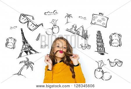 people, tourism, vacation and summer holidays concept - happy young woman or teen girl having fun making mustache of her hair strand over touristic doodles
