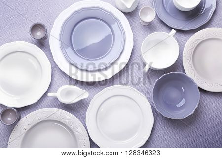 Empty dishes on grey background.