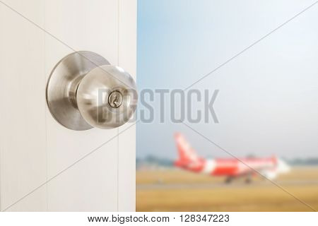 Door opening with blurred defocus airplane, concept of travel abroad, vacations and etc.
